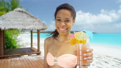 Beautiful African American girl with party cocktail drink on beach - stock footage