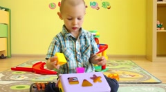 Child with educational toys in kindergarten Stock Footage