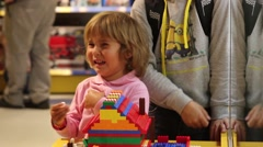 Little Girl Crying In Toy's Shop Stock Footage