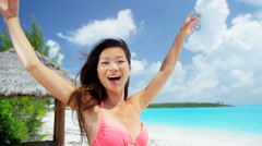 Smiling ethnic Asian Chinese girl outdoor beach resort - stock footage