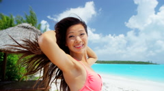 Ethnic Asian Chinese girl in swimwear at ocean beach resort Stock Footage