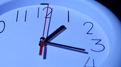 business white clock closeup on white background - stock footage