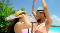 Happy African American Asian Chinese girls smiling on beach Stock Footage