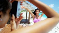 Multi ethnic girlfriends taking camera selfie on beach Stock Footage