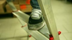 Feet rising on a ladder. Occupational safety and manpower. Stock Footage