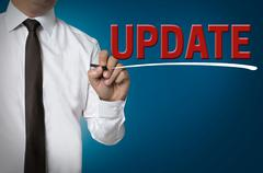 Update is written by businessman background concept Stock Photos