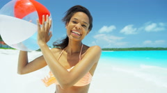 African American girl playing with beach ball at leisure resort - stock footage