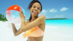 Smiling African American girl with beach ball at tourism resort - stock footage