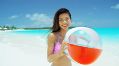 Ethnic Asian Chinese female enjoying vacation with beach ball - stock footage