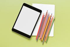Colored pencil , blank notebook and computer tablet Stock Photos
