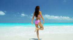 Asian Chinese girl wearing bikini at leisure vacation resort - stock footage