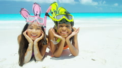 African American and Asian Chinese girls with snorkel equipment on beach - stock footage