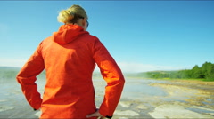 Iceland Geysir Strokkur female backpacker Golden Circle volcanic Stock Footage