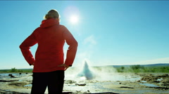 Iceland Geysir Strokkur female backpacker Golden Circle volcanic - stock footage