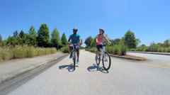 Young healthy African American guy and girl enjoying bike ride outdoors - stock footage