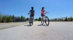Young active African American guy and girl enjoying biking outdoor on holiday - stock footage