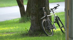 Bike parked near a tree in Munich Stock Footage