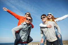 happy friends in shades having fun outdoors - stock photo