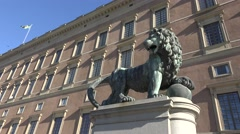 Royal palace and statue of a lion in Stockholm city  sweden Stock Footage