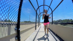 Young slim African American woman training on walkway outdoor Stock Footage