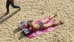 Young Woman Sunbathing On The Beach Stock Footage