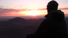 A Man Watches the Sunrise on Mount Sinai  - stock footage