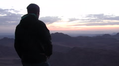 A Man Watches the Sunrise on Mount Sinai  Stock Footage