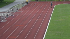 Man running on a running track at the Olympic Stadium, Munich Stock Footage