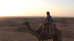A Young Man Rides a Camel at the Pyramids of Giza Stock Footage