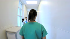 Young Caucasian American female doctor walking corridor in hospital Stock Footage