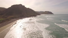 Aerial of a deserted surf beach Stock Footage