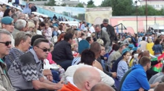 People sit on the rostrum at the celebration Day of the Airborne Forces Stock Footage