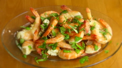 Delicious, appetising cooked shrimps & fresh basil plate, close up shot, zoom in Stock Footage