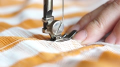 The woman starts to sew, spends seam round-trip - stock footage