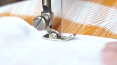 Close-up of the sewing at the manual sewing machine - stock footage