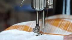 The process of sewing at the hand sewing machine - stock footage