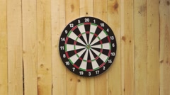 Someone throws a dart misses dart board Stock Footage