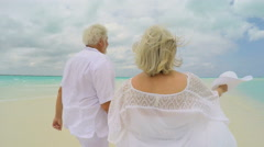 Mature Caucasian couple outdoor together on tropical beach vacation - stock footage