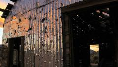 Stock Video Footage of Sunrise Sunset Over bullet-riddled abandoned mine