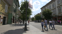 Friends walking on Nicolae Balcescu Street in Sibiu Stock Footage