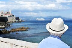 old man looking at the sea in Antibes, France, filtered - stock photo