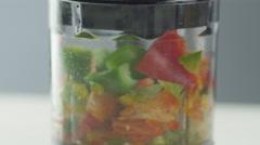 Vegetables in Blender. Close-up - stock footage