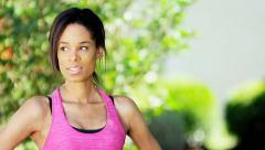 Young active African American female doing fitness activity outdoor - stock footage