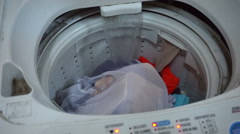 Household appliance - a top loading washing machine spinning in wash cycle Stock Footage