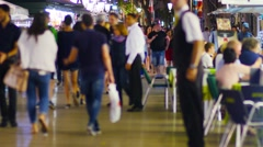 BARCELONA, multiple tourists strolling on Rambla boulevard at night. Stock Footage