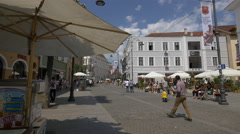 The crowded Nicolae Balcescu Street in Sibiu Stock Footage