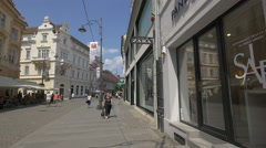 Walking on Nicolae Balcescu Street, near the Zara store in Sibiu Stock Footage
