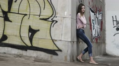 Upset depressed unhappy girl aimlessly standing alone. Stock Footage