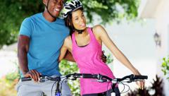 Young active African American male and female enjoying biking outdoor - stock footage