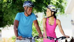 Young active African American couple enjoying biking outdoor - stock footage